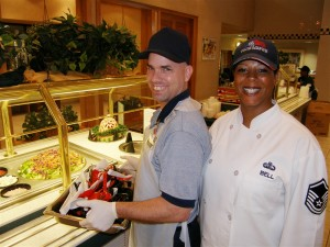 Two smiling food service workers