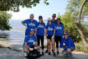 volunteers doing beach clean up