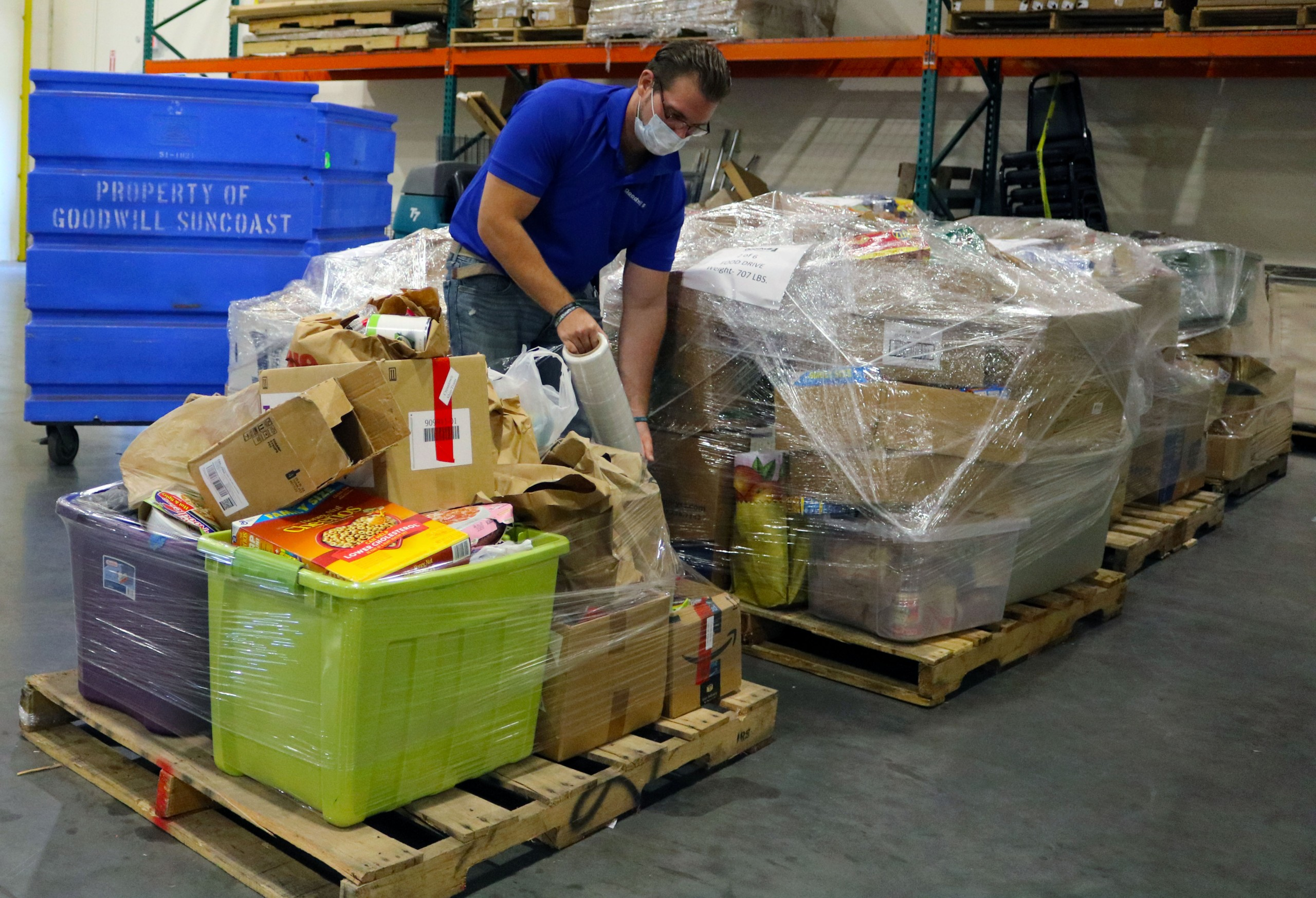 Goodwill staff prepares donated food for pickup